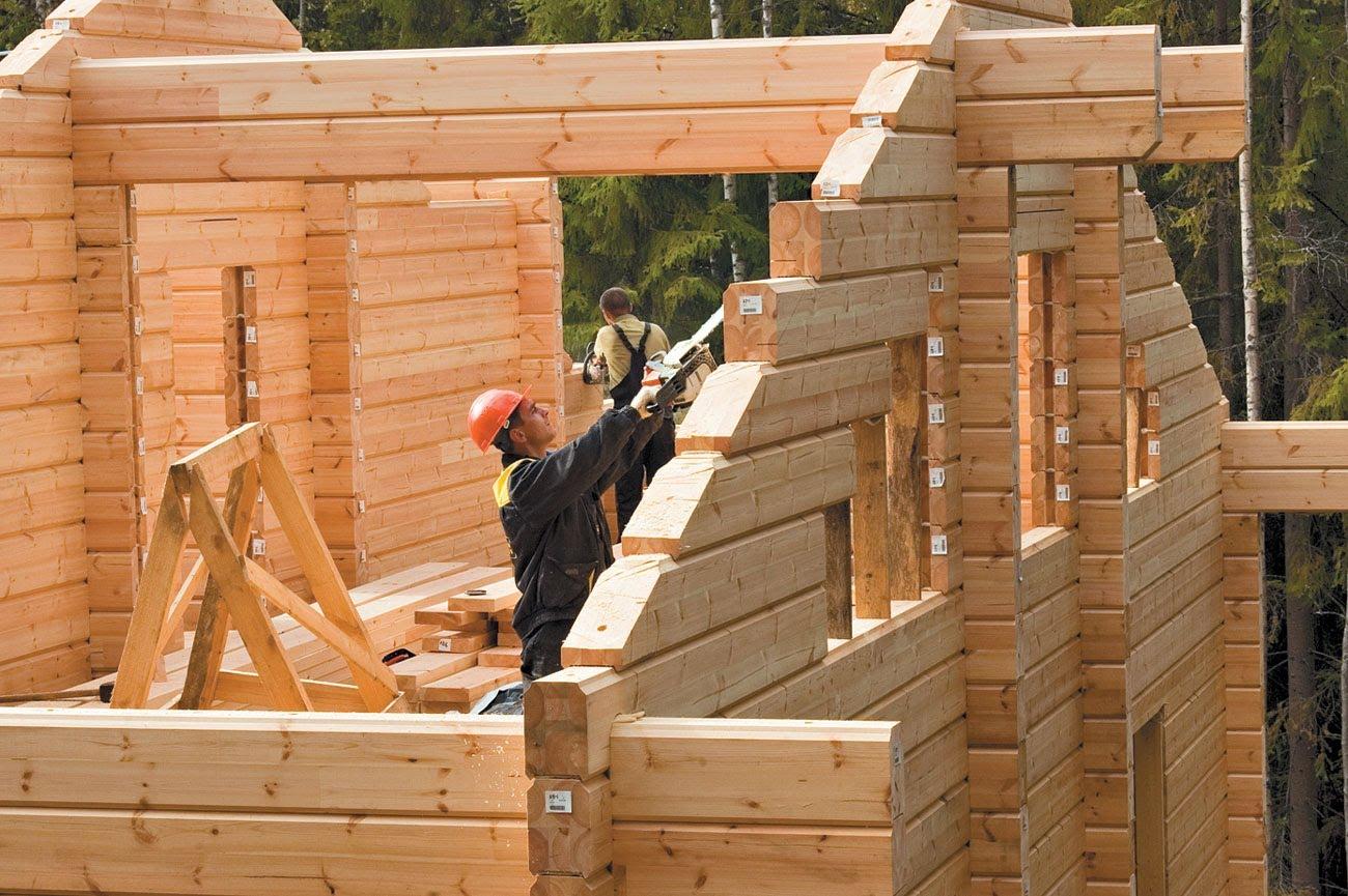 Фото деревянных домов построенных своими руками